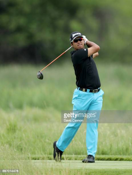 Hideki Matsuyama of Japan plays his tee shot at the par 4 second hole during the third round of the 117th US Open Championship at Erin Hills on June...