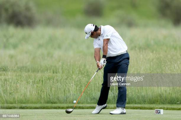 Hideki Matsuyama of Japan plays his tee shot at the par 4 second hole during the final round of the 117th US Open Championship at Erin Hills on June...