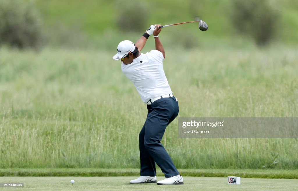 Hideki Matsuyama of Japan plays his tee shot at the par 4, second hole during the final round of the 117th US Open Championship at Erin Hills on June 18, 2017 in Hartford, Wisconsin.