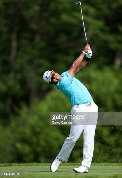 Hideki Matsuyama of Japan plays his tee shot on the par 3, 16th hole during the first round of the 117th US Open Championship at Erin Hills on June...