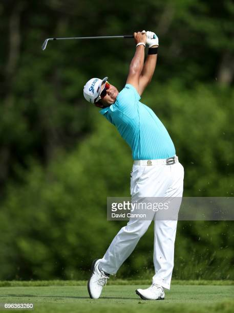 Hideki Matsuyama of Japan plays his tee shot on the par 3 16th hole during the first round of the 117th US Open Championship at Erin Hills on June 15...