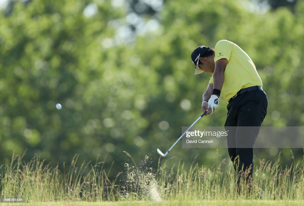 Hideki Matsuyama of Japan plays his tee shot on the par 3, 16th hole during the second round of the 117th US Open Championship at Erin Hills on June 16, 2017 in Hartford, Wisconsin.