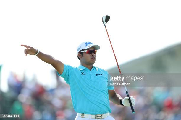 Hideki Matsuyama of Japan plays his tee shot on the par 5, 14th hole during the first round of the 117th US Open Championship at Erin Hills on June...