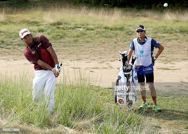 Hideki Matsuyama of Japan plays his third shot on the 12th hole during the second round of The Barclays in the PGA Tour FedExCup Play-Offs on the...