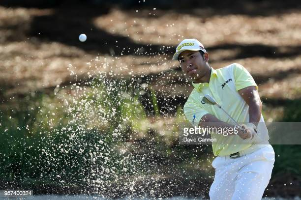 Hideki Matsuyama of Japan plays his third shot on the par 4 14th hole during the second round of the THE PLAYERS Championship on the Stadium Course...