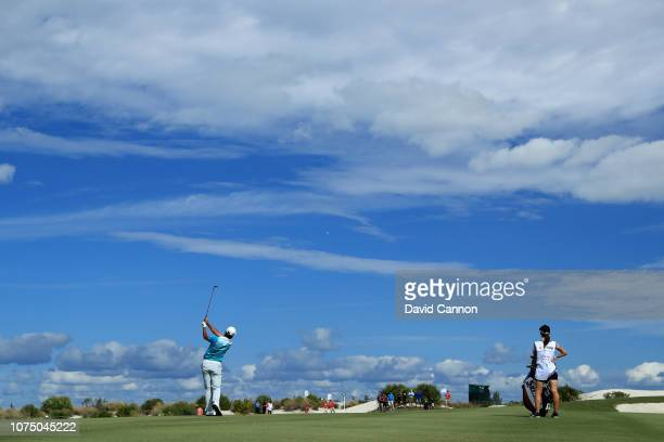 Hideki Matsuyama of Japan plays his third shot on the sixth hole during the second round of the 2018 Hero World Challenge at Albany Bahamas on...