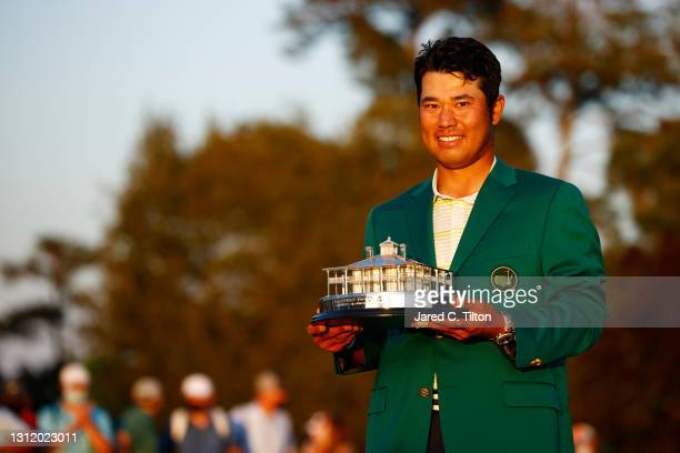 Hideki Matsuyama of Japan poses with the Masters Trophy during the Green Jacket Ceremony after winning the Masters at Augusta National Golf Club on...