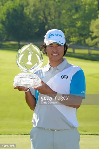 Hideki Matsuyama of Japan poses with the tournament trophy after winning the Memorial Tournament presented by Nationwide Insurance at Muirfield...
