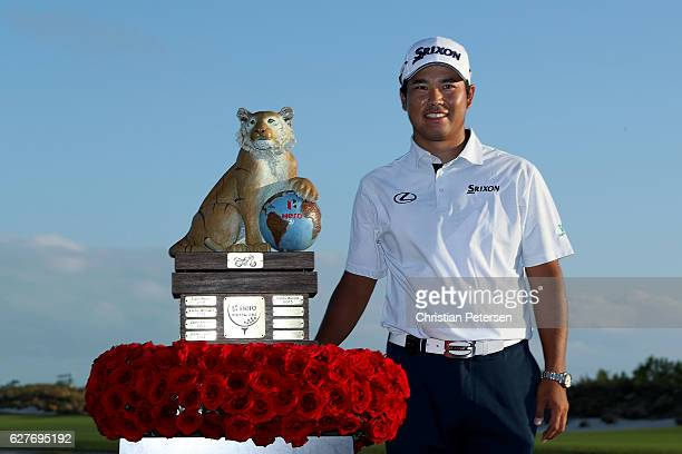 Hideki Matsuyama of Japan poses with the trophy after winning the Hero World Challenge at Albany The Bahamas on December 4 2016 in Nassau Bahamas