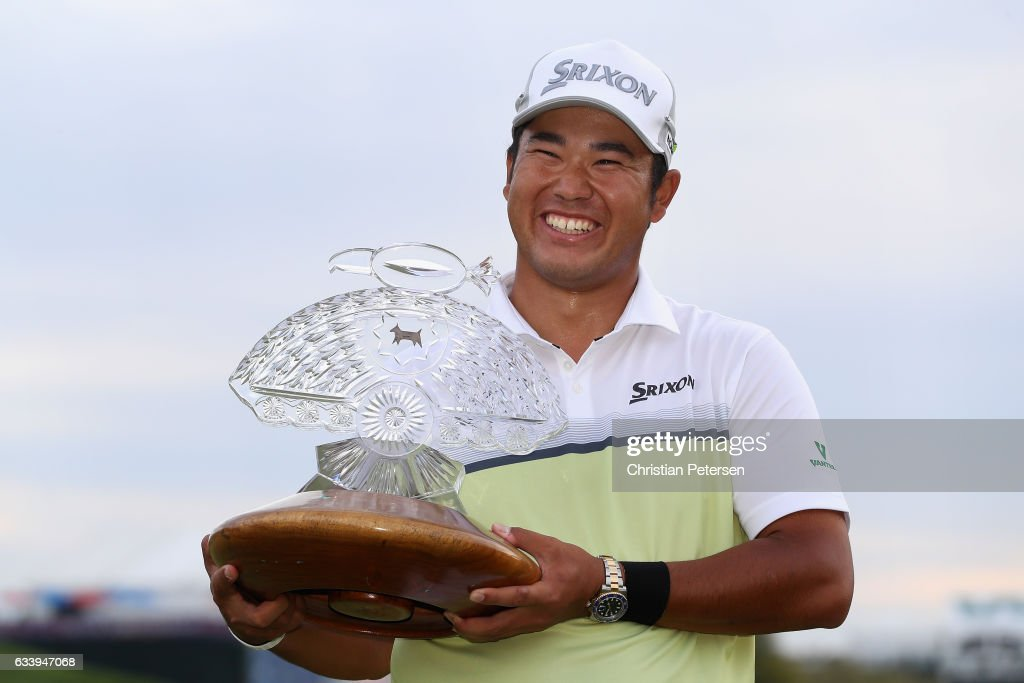 Hideki Matsuyama of Japan poses with the trophy after winning the Waste Management Phoenix Open on the fourth playoff hole at TPC Scottsdale on February 5, 2017 in Scottsdale, Arizona.