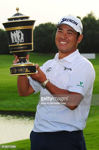 Hideki Matsuyama of Japan poses with the trophy after winning the WGC HSBC Champions at the Sheshan International Golf Club on October 30 2016 in...