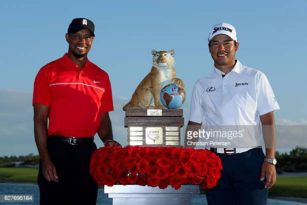 Hideki Matsuyama of Japan poses with the trophy and host Tiger Woods after winning the Hero World Challenge at Albany The Bahamas on December 4 2016...