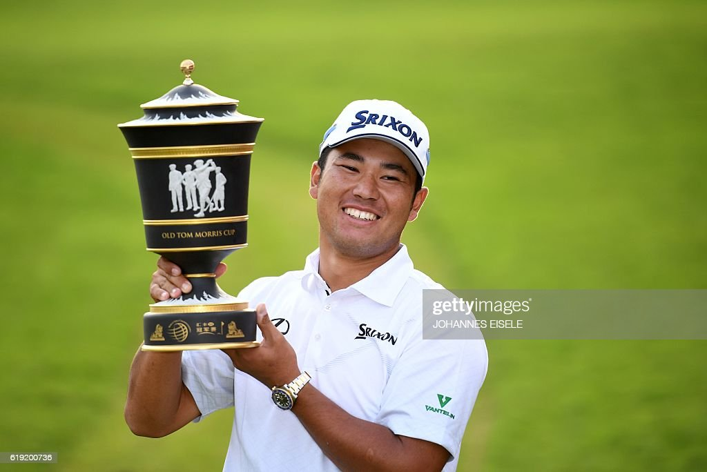 Hideki Matsuyama of Japan poses with the winner's trophy after the final round of the World Golf Championships-HSBC Champions golf tournament in Shanghai on October 30, 2016. / AFP / JOHANNES
