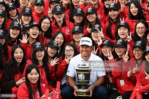 Hideki Matsuyama of Japan poses with the winner's trophy after the final round of the World Golf ChampionshipsHSBC Champions golf tournament in...