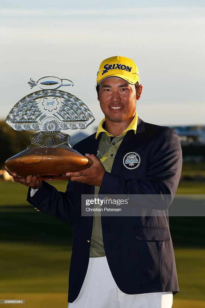 Hideki Matsuyama of Japan poses with the winners trophy on the 18th hole during the final round of the Waste Management Phoenix Open at TPC Scottsdale on February 7, 2016 in Scottsdale, Arizona.