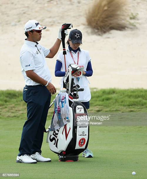 Hideki Matsuyama of Japan pulls a club on the third hole during the final round of the Hero World Challenge at Albany The Bahamas on December 4 2016...
