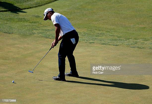 Hideki Matsuyama of Japan putts during a practice round prior to the start of the 113th U.S. Open at Merion Golf Club on June 12, 2013 in Ardmore,...