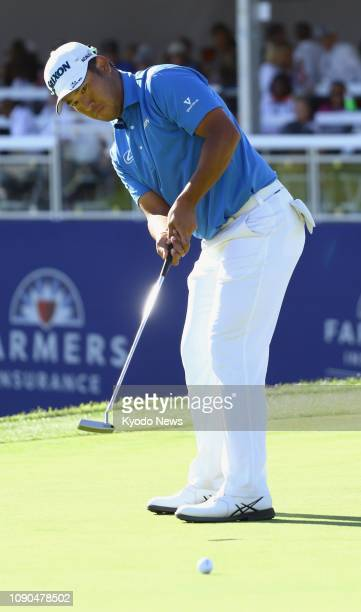 Hideki Matsuyama of Japan putts on the 17th hole during the final round of the Farmers Insurance Open at the Torrey Pines Golf Club in La Jolla...