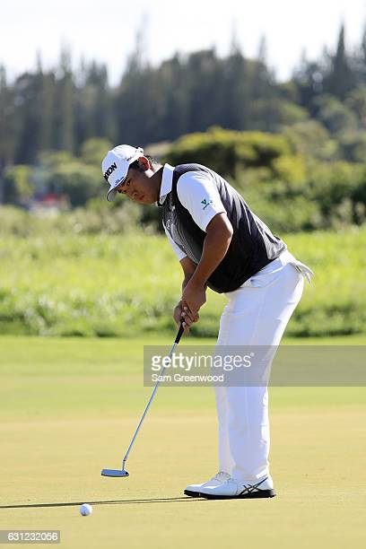 Hideki Matsuyama of Japan putts on the second green during the final round of the SBS Tournament of Champions at the Plantation Course at Kapalua...