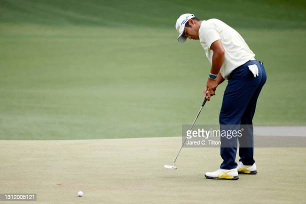 Hideki Matsuyama of Japan putts on the sixth green during the final round of the Masters at Augusta National Golf Club on April 11, 2021 in Augusta,...
