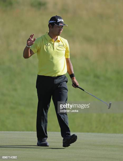 Hideki Matsuyama of Japan reacts after making a birdie on the 13th green during the second round of the 2017 U.S. Open at Erin Hills on June 16, 2017...