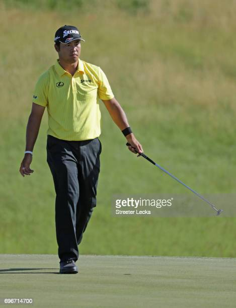 Hideki Matsuyama of Japan reacts after making a birdie on the 13th green during the second round of the 2017 US Open at Erin Hills on June 16 2017 in...