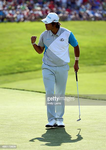 Hideki Matsuyama of Japan reacts after making his birdie putt on the 18th hole during the final round of the Memorial Tournament presented by...
