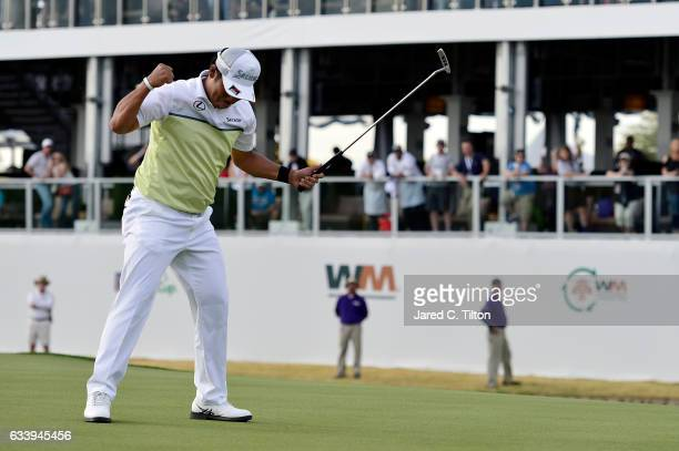 Hideki Matsuyama of Japan reacts after making his birdie putt on the fourth playoff hole on the 17th green during the final round of the Waste...