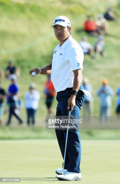 Hideki Matsuyama of Japan reacts after making par on the 17th green during the final round of the 2017 US Open at Erin Hills on June 18 2017 in...
