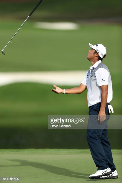 Hideki Matsuyama of Japan reacts by throwing his putter as he just misses a short par putt on the par 4 16th hole during the final round of the 2017...