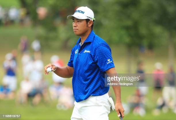 Hideki Matsuyama of Japan reacts on the 15th green during the final round of the BMW Championship at Medinah Country Club No 3 on August 18 2019 in...