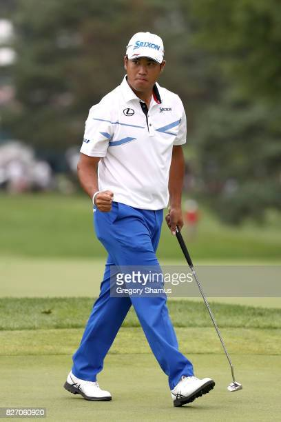 Hideki Matsuyama of Japan reacts on the 17th green during the final round of the World Golf Championships Bridgestone Invitational at Firestone...
