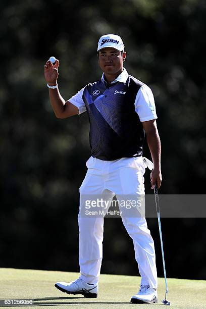 Hideki Matsuyama of Japan reacts on the 18th green during the final round of the SBS Tournament of Champions at the Plantation Course at Kapalua Golf...