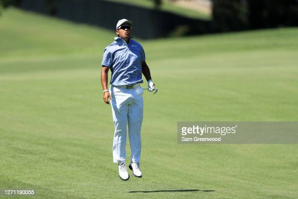 Hideki Matsuyama of Japan reacts on the first hole during the final round of the TOUR Championship at East Lake Golf Club on September 07 2020 in...