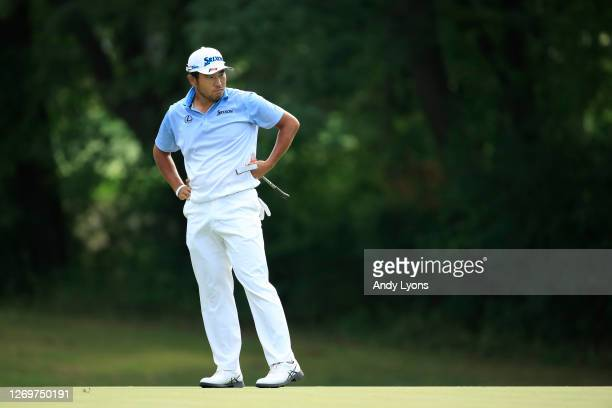 Hideki Matsuyama of Japan reacts to a missed birdie putt on the 14th hole during the final round of the BMW Championship on the North Course at...