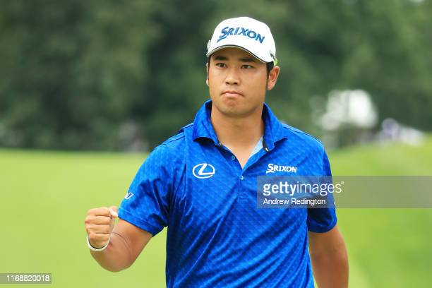 Hideki Matsuyama of Japan reacts to his birdie on the 14th hole during the final round of the BMW Championship at Medinah Country Club No 3 on August...