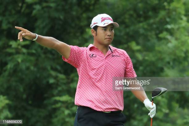 Hideki Matsuyama of Japan reacts to his shot from the fifth tee during the third round of the BMW Championship at Medinah Country Club No 3 on August...