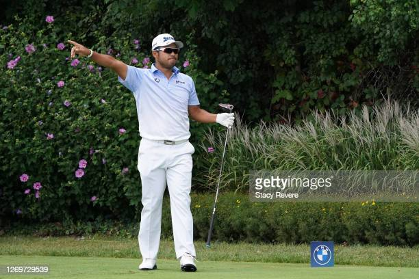 Hideki Matsuyama of Japan reacts to his shot from the first tee during the final round of the BMW Championship on the North Course at Olympia Fields...