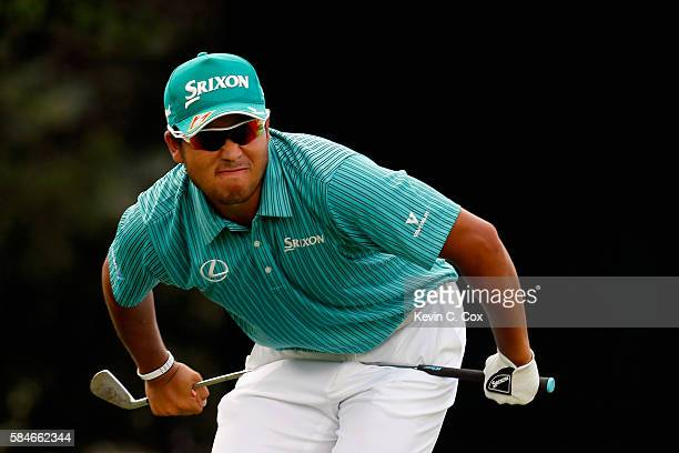Hideki Matsuyama of Japan reacts to his tee shot on the 12th hole during the second round of the 2016 PGA Championship at Baltusrol Golf Club on July...