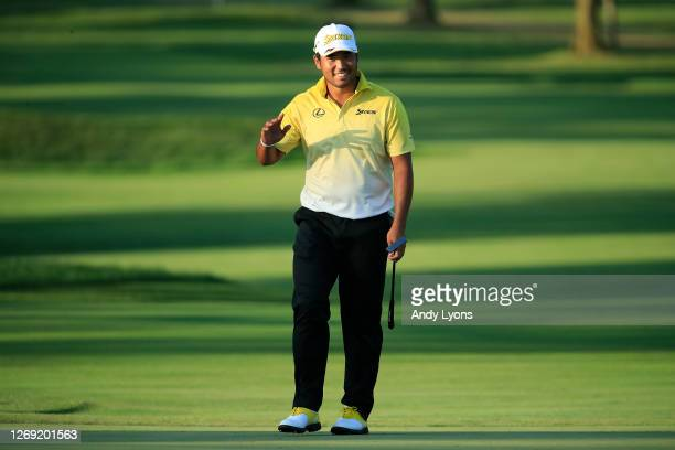 Hideki Matsuyama of Japan reacts to making a long putt on the ninth green during the first round of the BMW Championship on the North Course at...