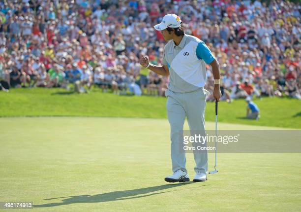 Hideki Matsuyama of Japan rmakes a birdie putt on the 18th green to force a playoff against Kevin Na during the final round of the Memorial...