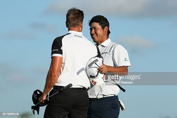Hideki Matsuyama of Japan shakes hands with Henrik Stenson of Sweden after Matsuyama won the Hero World Challenge at Albany The Bahamas on December 4...