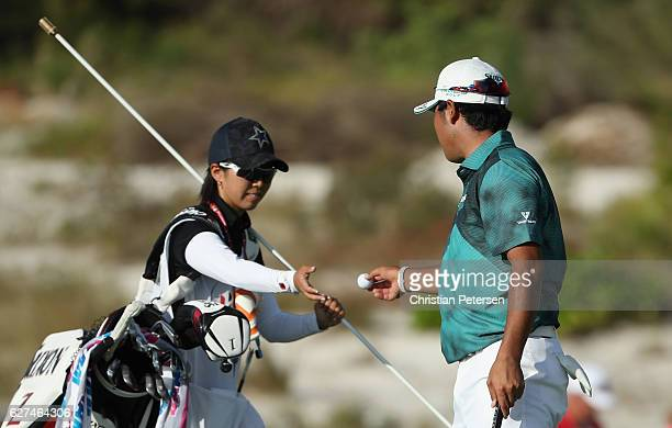 Hideki Matsuyama of Japan shows camaraderie with his caddie during round three of the Hero World Challenge at Albany The Bahamas on December 3 2016...