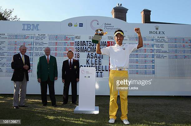 Hideki Matsuyama of Japan stands with the trophy after winning the 2010 Asian Amateur Championship at Kasumigaseki Country Club on October 10, 2010...