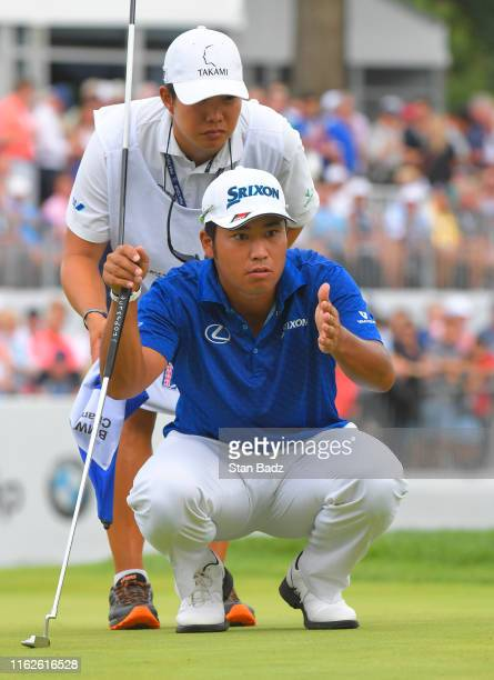 Hideki Matsuyama of Japan studies his putt on the 18th hole during the final round of the BMW Championship at Medinah Country Club on August 18 2019...