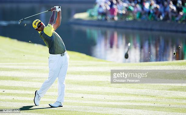 Hideki Matsuyama of Japan takes his second shot on the 18th hole during the final round of the Waste Management Phoenix Open at TPC Scottsdale on...
