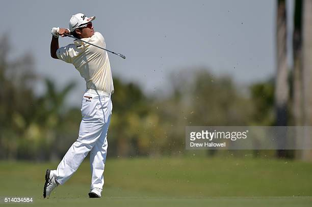 Hideki Matsuyama of Japan takes his second shot on the eighth hole during the final round of the World Golf ChampionshipsCadillac Championship at...
