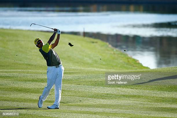 Hideki Matsuyama of Japan takes his shot during the second playoff hole during the final round of the Waste Management Phoenix Open at TPC Scottsdale...