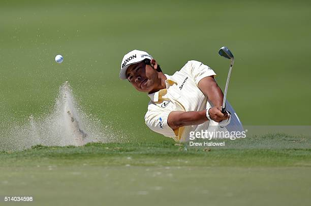 Hideki Matsuyama of Japan takes his third shot on the eighth hole during the final round of the World Golf ChampionshipsCadillac Championship at...