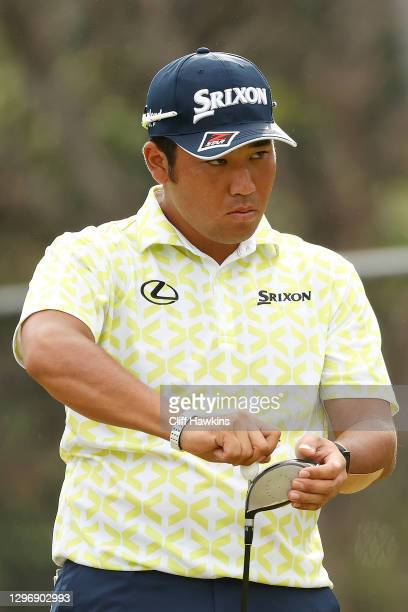 Hideki Matsuyama of Japan tightens his driver on the first tee during the final round of the Sony Open in Hawaii at the Waialae Country Club on...